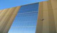 Standing seam cellular polycarbonate panels on a building