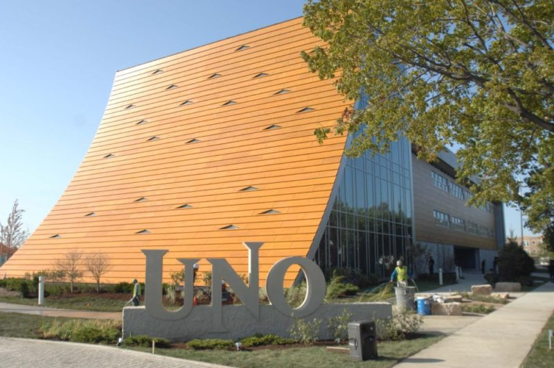 custom designed facade - EXTECH's custom Prodema panel facade for the UNO School in Chicago, IL