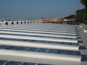 long glass industrial skylights - EXTECH's Custom Glass Skylights with PV Panels at DDC-DEP Remsen Avenue Yard in Brooklyn, NY